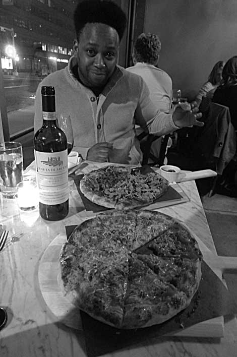 Black Dwayne diggin' his new do, the wine and the pizza.